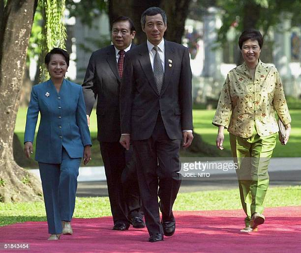 Philippine President Gloria Arroyo her husband Jose Miguel Arroyo Singapore Prime Minister Lee Hsien Loong and his wife Lee Ho Ching walk in the park...