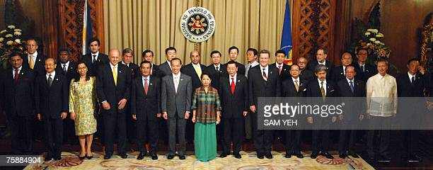 Philippine President Gloria Arroyo poses for photo with 27 ministers of the Association of Southeast Asian Nations dialogue partners and ASEAN...
