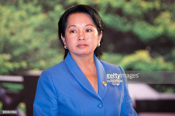 Philippine President Gloria Macapagal Arroyo poses during the declaration ceremony at the end of the the APEC Summit on November 15 in Singapore.