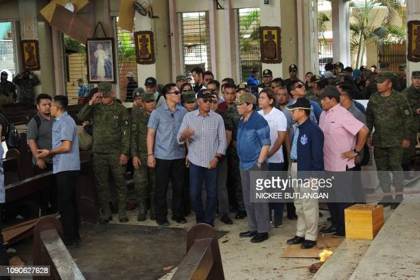 Philippine President Rodrigo Duterte accompanied by Defense Secretary Delfin Lorenzana inspect the damage area of a catholic cathedral in Jolo town...