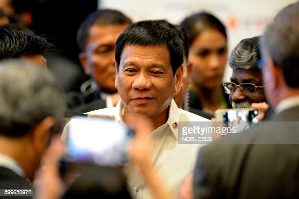 Philippine President Rodrigo Duterte arrives for the Association of Southeast Asian Nations Business and Investment Summit in Vientiane on September...