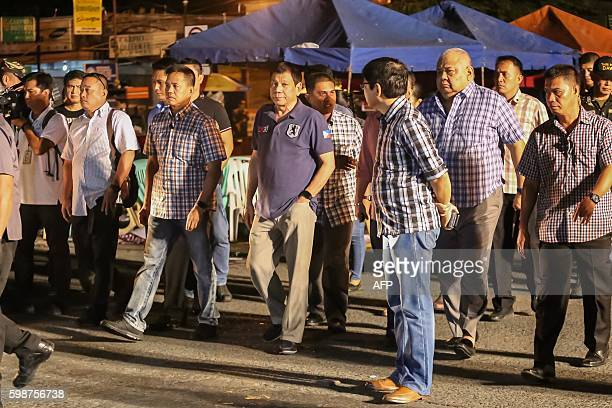 Philippine President Rodrigo Duterte arrrives at the site of an explosion at a nigth market in Davao City in southern island of Mindanao early...
