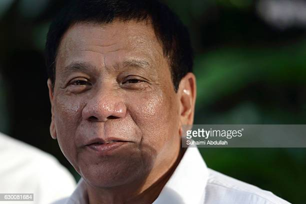 Philippine President Rodrigo Duterte attends the orchid naming ceremony at the National Orchid Garden on December 16 2016 in Singapore Duterte is on...