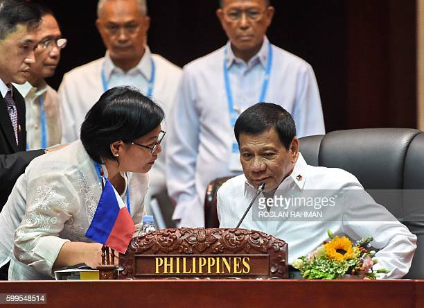 Philippine President Rodrigo Duterte attends the plenary session of the Association of Southeast Asian Nations Summit in Vientiane on September 6...
