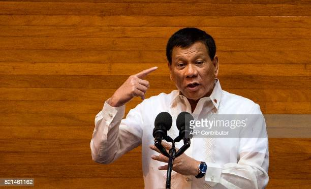 Philippine President Rodrigo Duterte gestures as he delivers his state of the nation address at Congress in Manila on July 24 2017 Philippine...