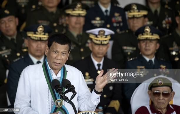 Philippine President Rodrigo Duterte gestures as he gives a speech during the Armed Forces of the Philippines change of command ceremony at the AFP...
