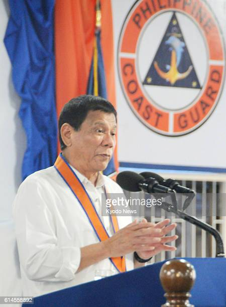 Philippine President Rodrigo Duterte gives a speech during a ceremony on Oct 12 in Manila to commission a patrol vessel provided by Japan