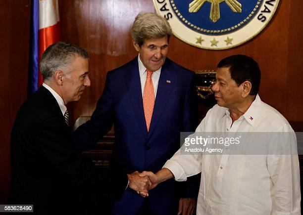 Philippine President Rodrigo Duterte greets US Secretary of State John Kerry during his visit at the Malacanang presidential palace in Manila...