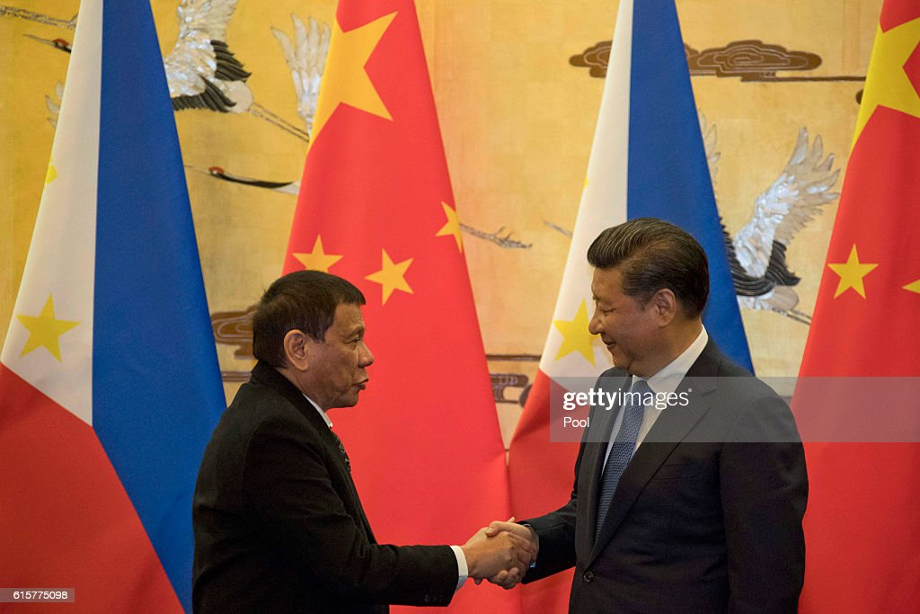 Philippine President Rodrigo Duterte, left and Chinese President Xi Jinping shakes hands after a signing ceremony on October 20, 2016 in Beijing, China. Philippine president Rodrigo Duterte is on a four-day state visit to China, his first since taking power in late June, with the aim of improving bilaterial relations.