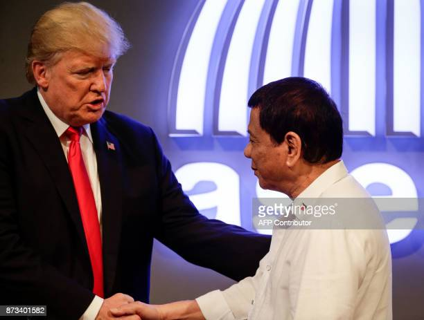 Philippine President Rodrigo Duterte listens to US President Donald J Trump before the opening ceremony of the 31st Association of South East Asian...