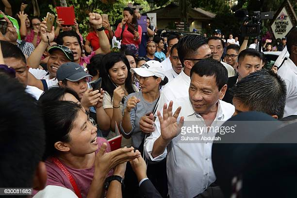 Philippine President Rodrigo Duterte meets with the Filipino community after the orchid naming ceremony outside the National Orchid Garden on...