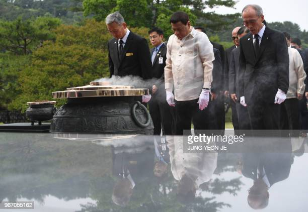Philippine President Rodrigo Duterte pays a silent tribute at the National Cemetery in Seoul on June 4 2018 Duterte is in Seoul for a threeday visit...