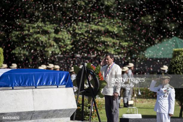 Philippine President Rodrigo Duterte salutes at the Tomb of the Unknown Soldier during a ceremony on National Heroes' Day at the Heroes Cemetery in...