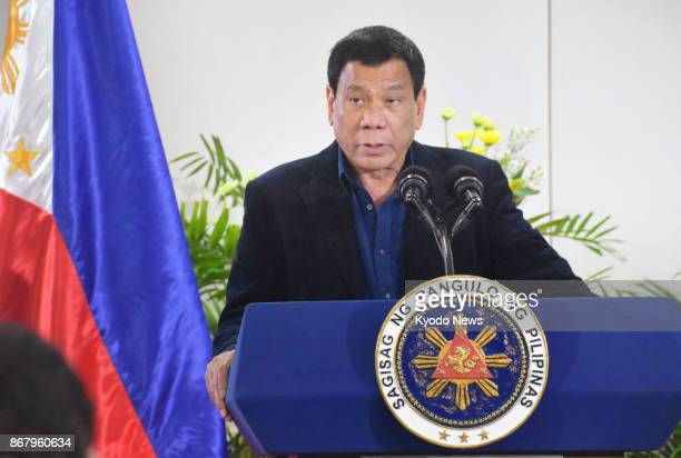 Philippine President Rodrigo Duterte speaks at a press conference in Davao on Oct 29 the eve of his trip to Japan Duterte called on Japan the United...