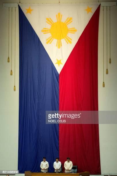 Philippine President Rodrigo Duterte stands with Senate President Aquilino Pimentel and House Speaker Pantaleon Alverez before delivering his state...