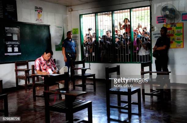 Philippine presidential candidate and Davao City Mayor Rodrigo Duterte casts his vote at a voting precint at Daniel Aguinaldo National High School in...