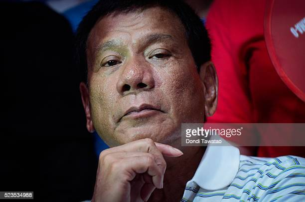 Philippine presidential candidate Rodrigo Duterte listens to political speeches during a campaign rally on April 23 2016 in Manila Philippines The...