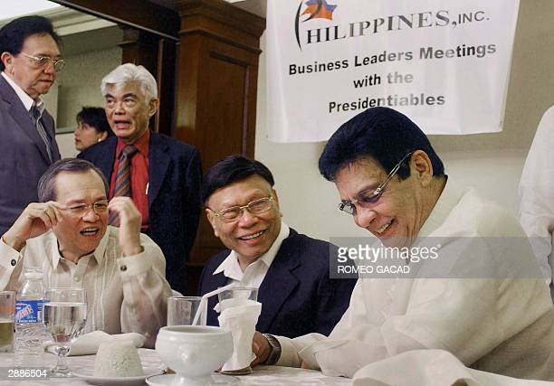 Philippine presidential frontrunner Fernando Poe meets for the first time the country's business leaders Jesus Pineda Felimon Cuevas during a forum...