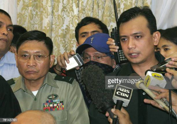 Philippine rebel officer army Brigadier General Danilo Lim looks on while Antonio Trillanes a navy lieutenant who was elected senator in May...