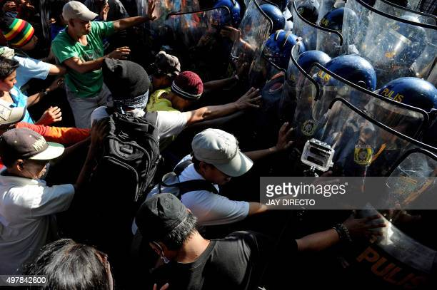 Philippine riot police block off protesters marching to voice their opposition to the Asia-Pacific Economic Cooperation Summit taking place in Manila...