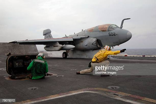 philippine sea (december 1, 2006) - an ea-6b prowler assigned to electronic warfare squadron one three six (vaq-136) launches off the flight deck of uss kitty hawk - aircraft carrier stock pictures, royalty-free photos & images