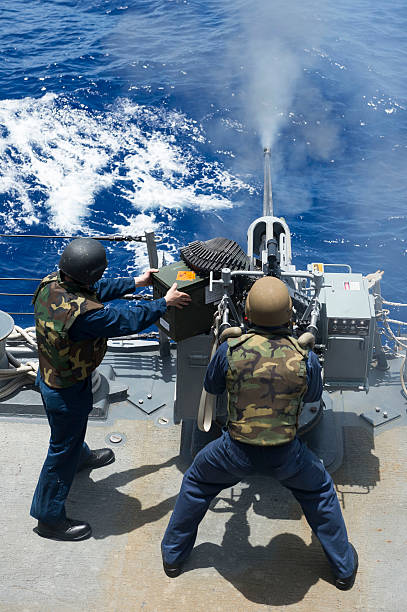 Philippine Sea, August 11, 2013 - Electronics Technician fires a 25mm machine gun aboard the guided-missile destroyer USS Preble (DDG-88) during a live-fire weapons shoot.