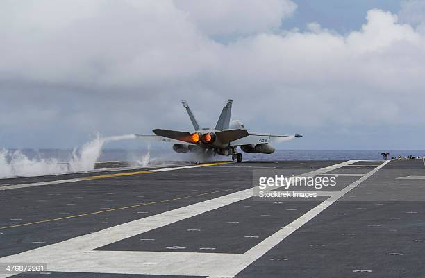 Philippine Sea, August 17, 2013 - An F/A-18E Super Hornet takes off from the flight deck of the U.S. Navy's forward-deployed aircraft carrier USS George Washington.