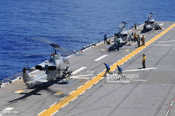 Philippine Sea, September 28, 2011 - AH-1Z Super Cobra helicopters land aboard the forward deployed amphibious assault ship USS Essex (LHD 2).