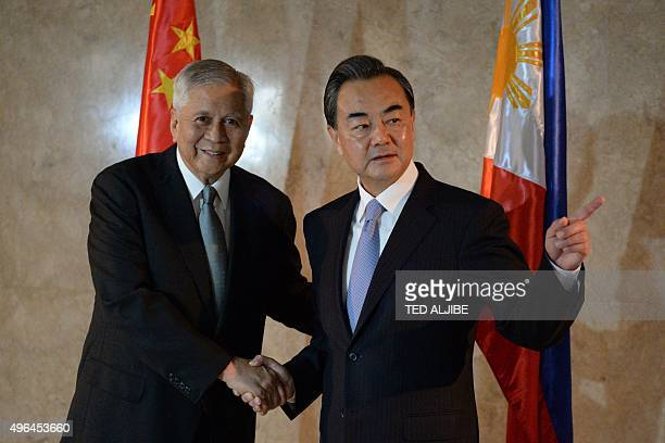 Philippine Secretary of Foreign Affairs Albert del Rosario shakes hands with his Chinese counterpart Wang Yi prior to their meeting at the foreign...