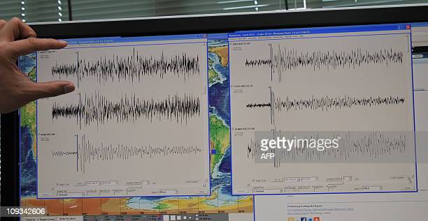 Philippine seismologist Winchelle Sevilla points to a seismograph of an earthquake which struck New Zealand earlier in the day during a press...