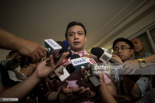 Philippine senator Antonio Trillanes answers questions from the press after arriving at his house in Antipolo east of Manila on September 29 2018...