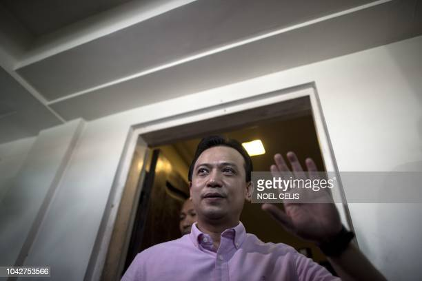 Philippine senator Antonio Trillanes gestures at the door of his house in Antipolo east of Manila on September 29 2018 Lawmaker Trillanes locked in a...
