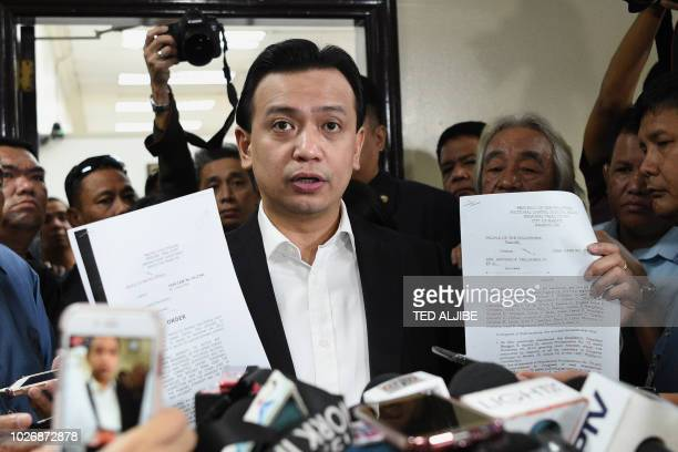 Philippine Senator Antonio Trillanes holds court documents during a standup press conference at the Senate in Manila on September 5 2018 Philippine...