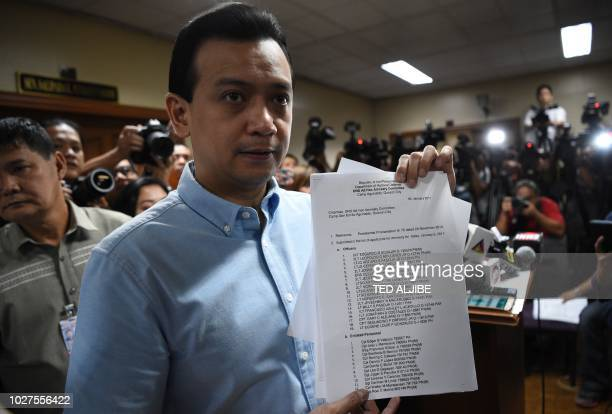 Philippine Senator Antonio Trillanes holds up documents as he speaks during a press conference at the senate in Manila on September 6 2018 Trillanes...