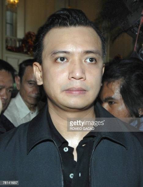 Philippine Senator Antonio Trillanes leader of the rebel soldiers who have taken over the luxury Peninsula hotel faces journalists inside the hotel...