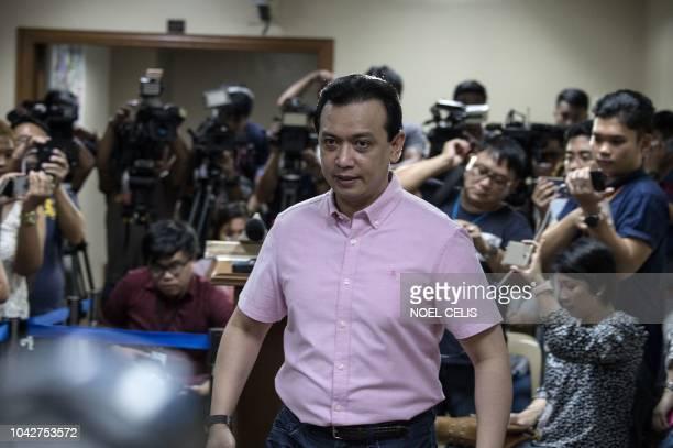 Philippine senator Antonio Trillanes leaves the senate building after a press conference in Manila on September 29 2018 Lawmaker Trillanes locked in...