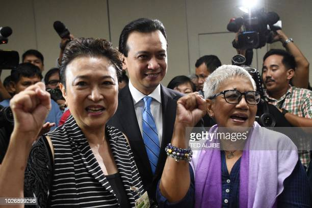 Philippine Senator Antonio Trillanes poses for photos with his supporters including former secretary of peace process Teresita Delis at the Senate in...