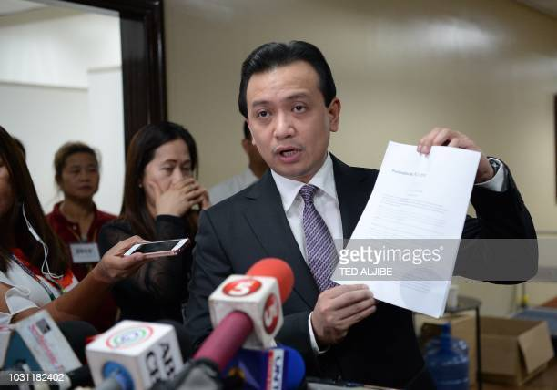 Philippine Senator Antonio Trillanes shows documents during a press conference at the senate in Manila on September 11 hours after President Rodrigo...