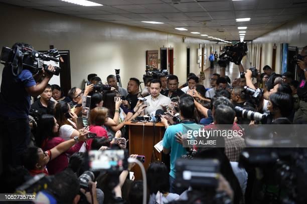 Philippine Senator Antonio Trillanes speaks to members of the media at the senate building in Manila on October 22 after a local court denied a...