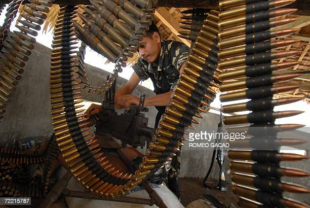 Philippine soldier readies a machine gun installed on a watch tower at a military camp in Villahermosa Albay province in Luzon island 17 October 2006...