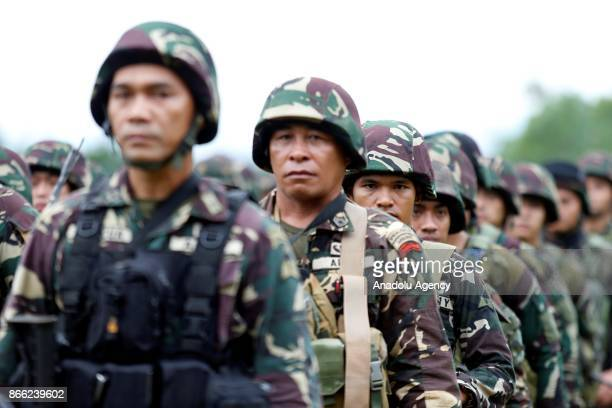 Philippine soldiers are lined up during their send off ceremony in Marawi Lanao del Sur in the Southern Philippines on October 25 2017 The military...