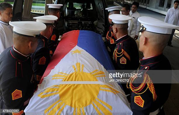 Philippine soldiers carry the flag-draped coffin of Filipino ambassador to Pakistan, Domingo D. Lucenario Jr, during a ceremony by the Philippines...