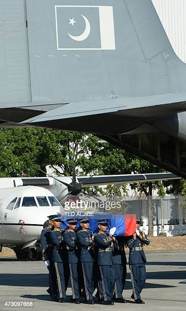 Philippine soldiers carry the flag-draped coffin of the late Philippine ambassador to Pakistan Domingo Lucenario from a Pakistani Air Force C-130...