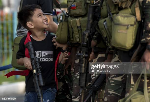 Philippine soldiers from Marawi are welcomed home by their relatives at Villamor Airbase in Manila on October 20 2017 ProIS gunmen occupied parts of...