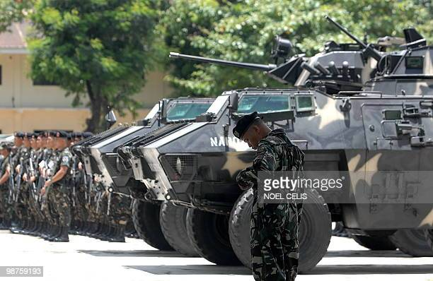 Philippine soldiers stand in formation near an Armored Personnel Carrier during a show of force in preparation for the May 10 elections at the...