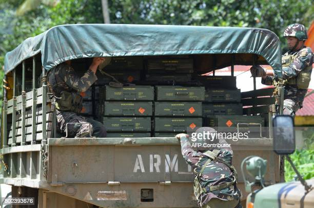Philippine soldiers transport ammunition headed for troops in the frontline fighting Islamist militants in the outskirts of Marawi on the southern...