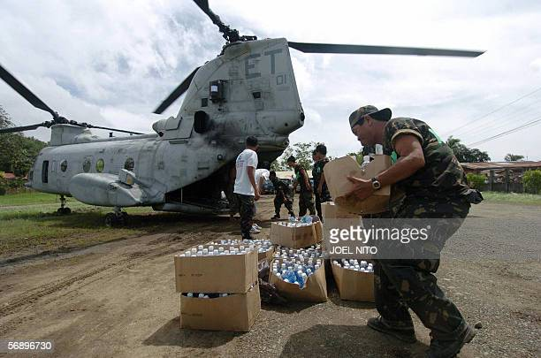 Philippine soldiers unload relief supplies from a US sea knight helicopter in Saint Bernard town southern Leyte in central Philippines 19 February...