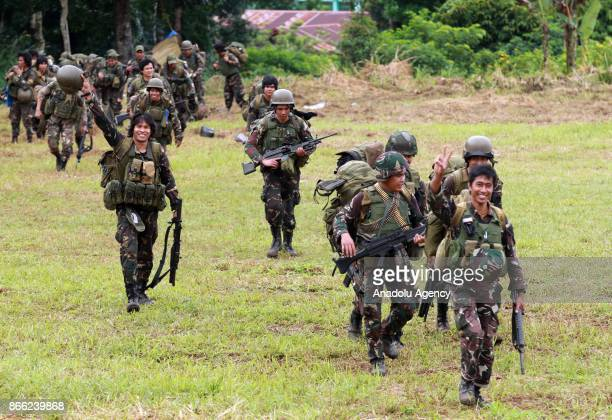 Philippine soldiers walk following their send off ceremony in Marawi Lanao del Sur in the Southern Philippines on October 25 2017 The siege began on...