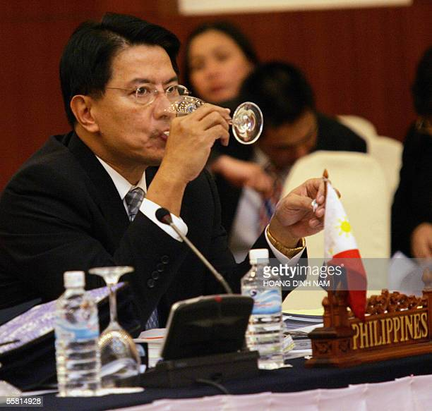 Philippine State Secretary in charge of Asean Free Trade Area Peter Favilla drinks water as he attends the meeting of the Southeast Asian Economics...