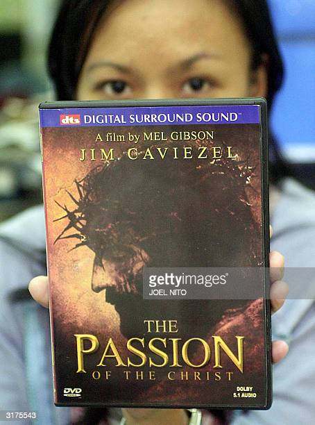 Philippine student shows a pirated DVD copy of Mel Gibson's controversial film The Passion of the Christ which opened in local theaters 31 March 2004...